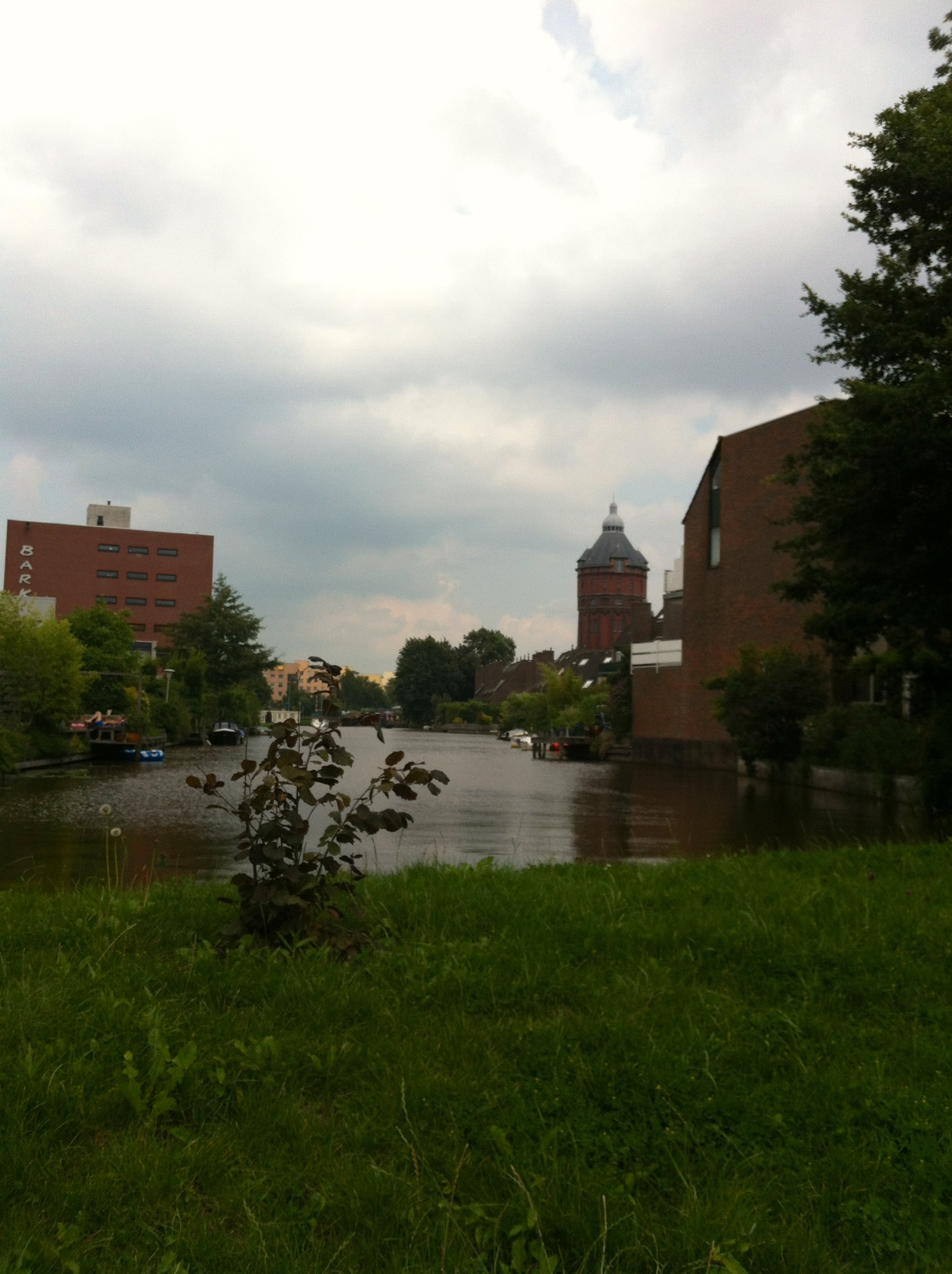 Photo of a canal and a tower-like building.