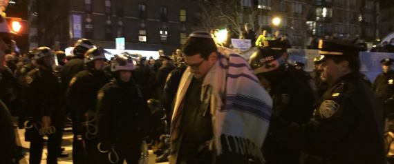 Rabbi Shai Held prays while being arrested at a protest for Eric Garner.