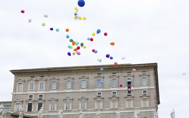 Balloons released from the Pope's studio overlooking St. Peter's Square.