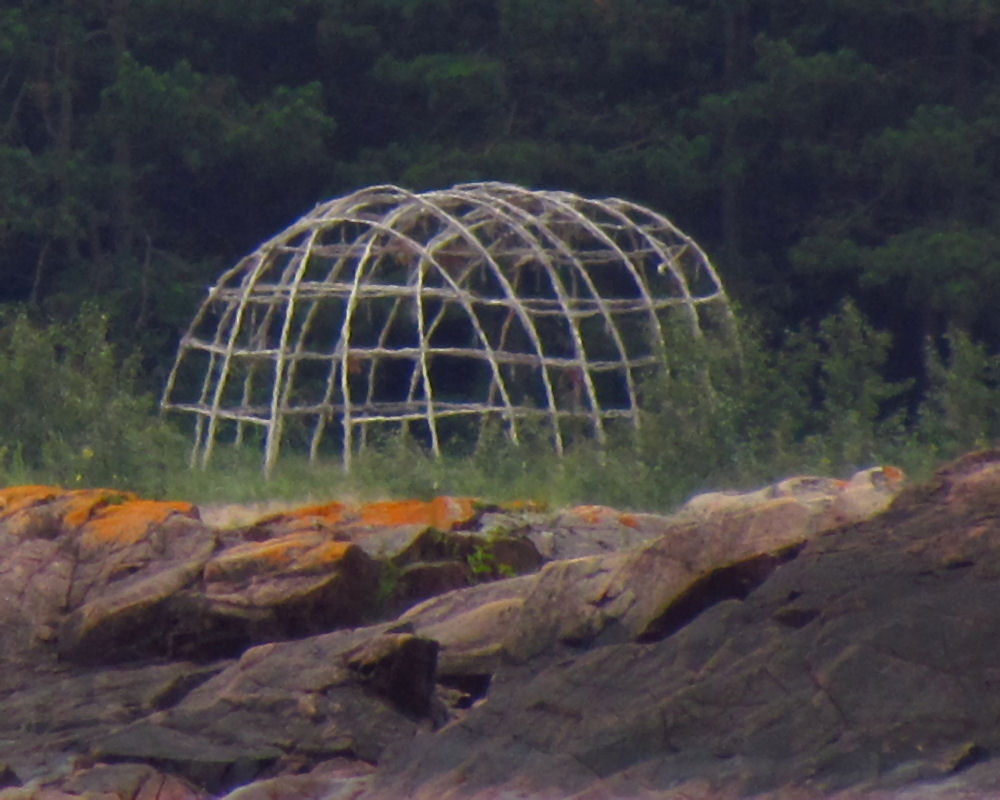 Frame of a sweat lodge in Lake Superior.